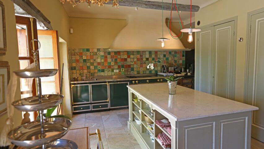 Bastide Provencale rustic kitchen with multicoloured tiles