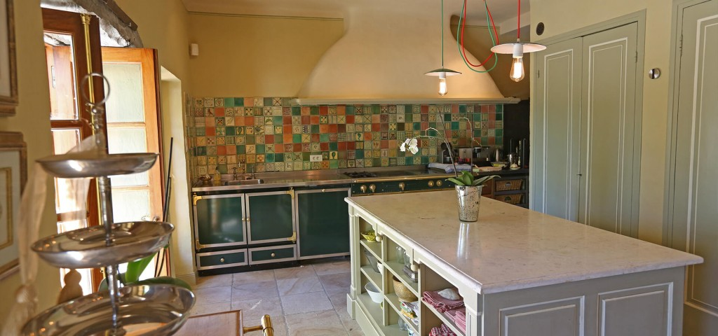 Bastide Provencale rustic kitchen with multicoloured tiles