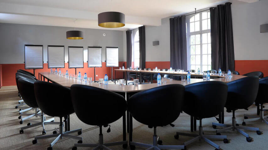 Chateau Perche conference room with dark chairs