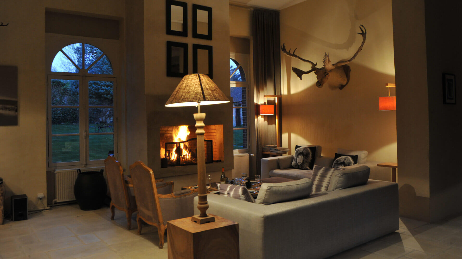 Chateau Perche living room area with rustic feel and fireplace
