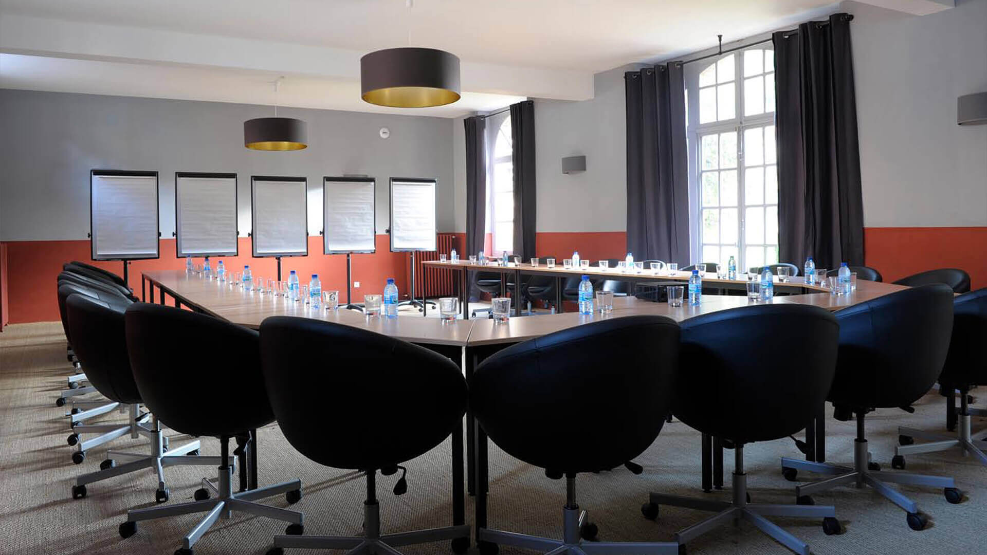 Chateau Perche black chairs in big conference room