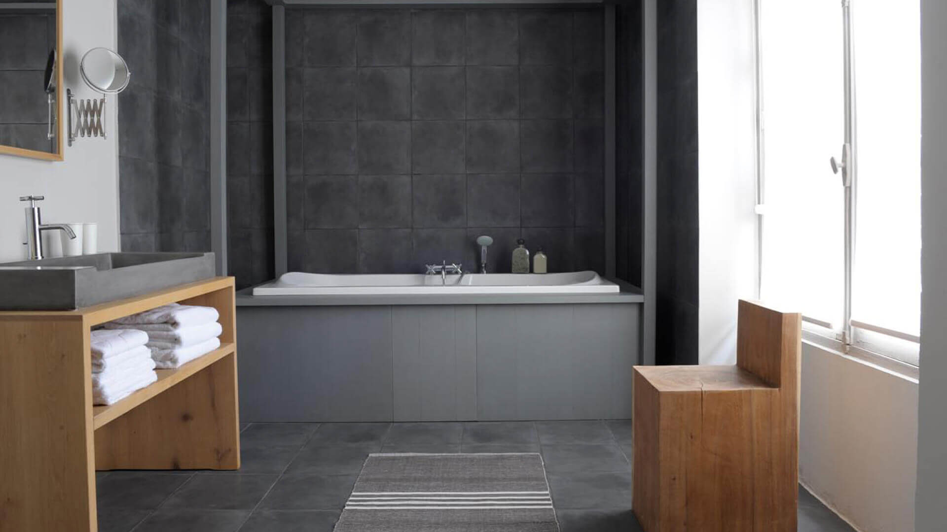 Chateau Perche bathroom with dark tiles and bathtub