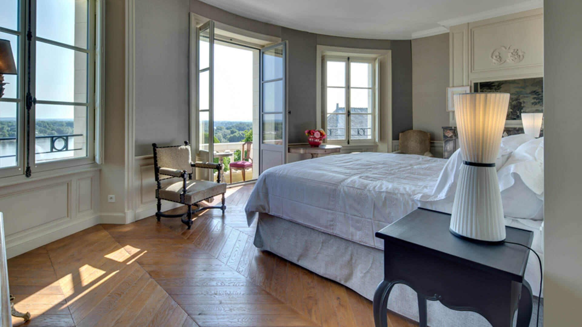 Chateau in loire master bedroom with view of lake