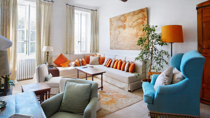 Large Domain Valbonne living room sofa with orange pillows