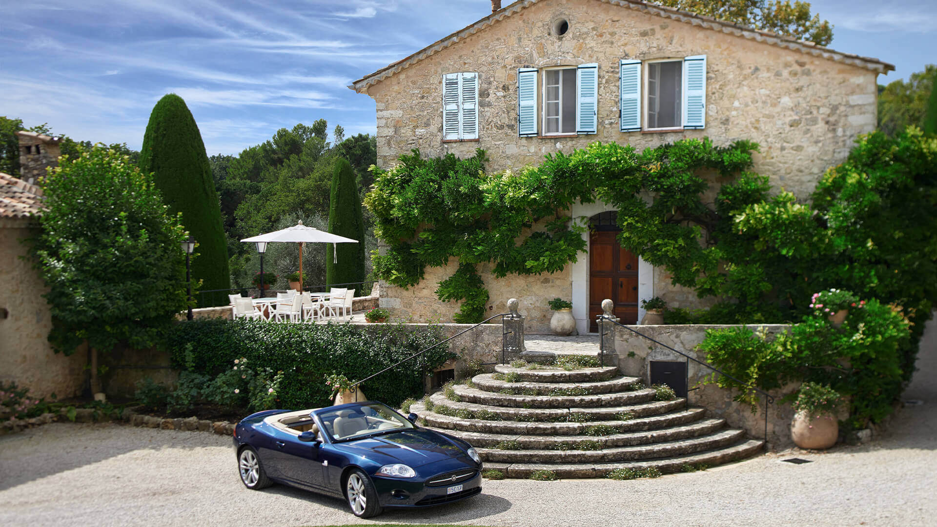 Large Domain Valbonne entrance to villa with jaguar in front