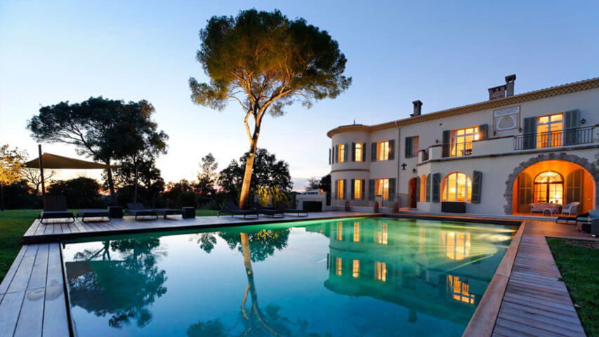 Large luxury Chateau garden and swimming pool at night