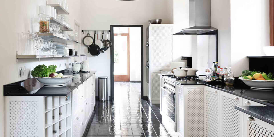 Large property outside Barcelona with black and white kitchen