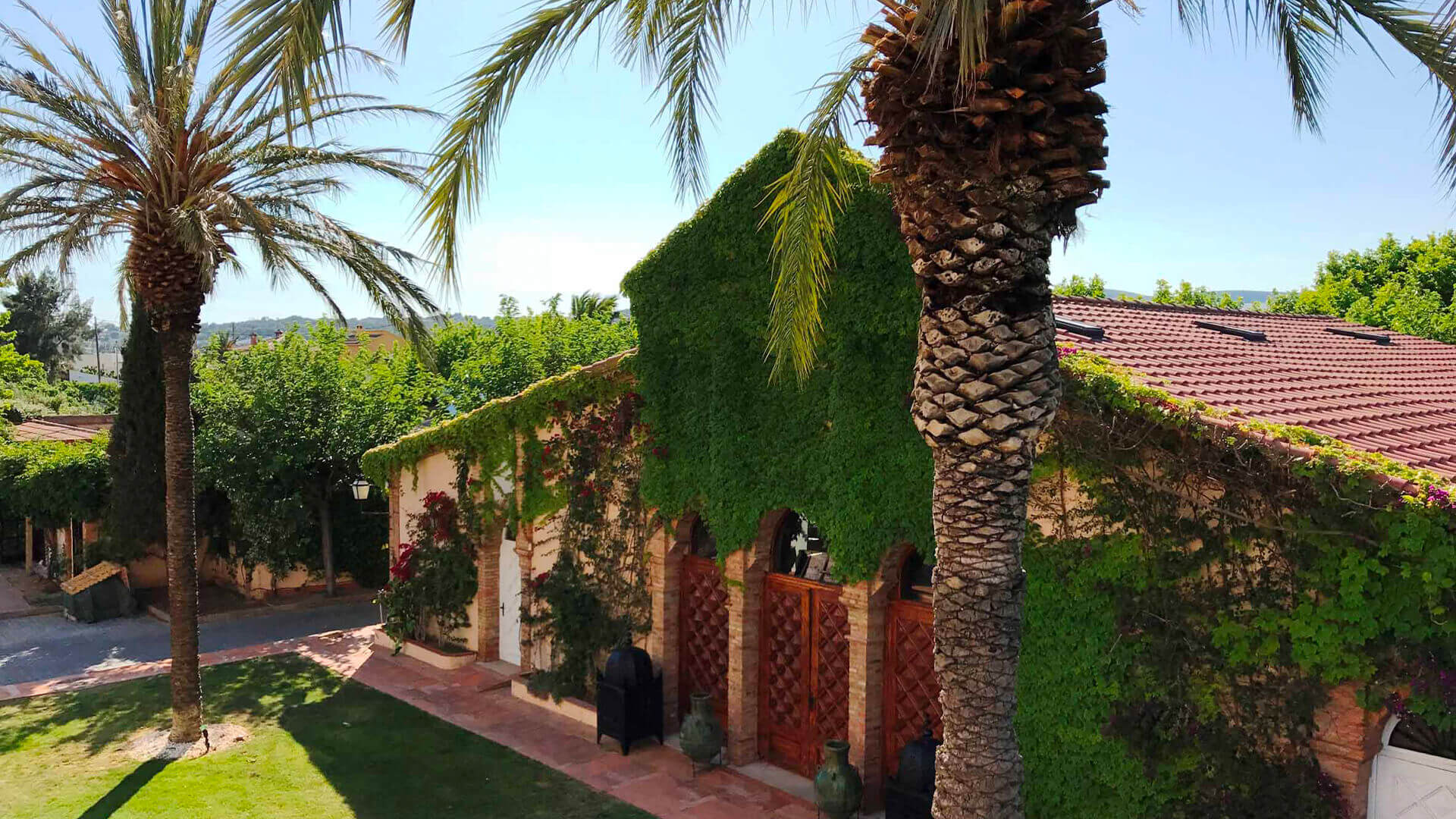 Large property outside Barcelona villa garden with palms and plants