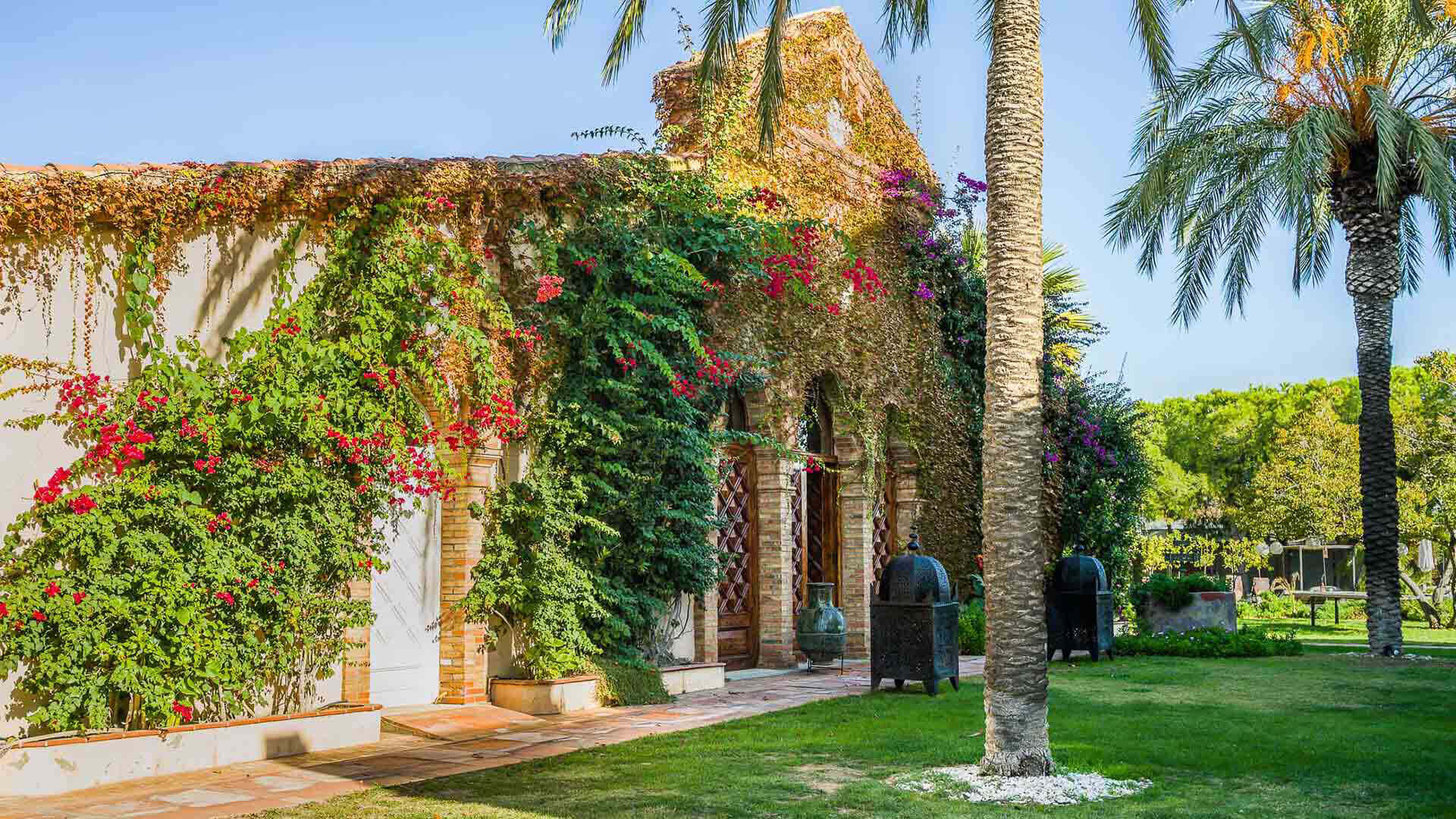 Large property outside Barcelona building overgrown with flowers