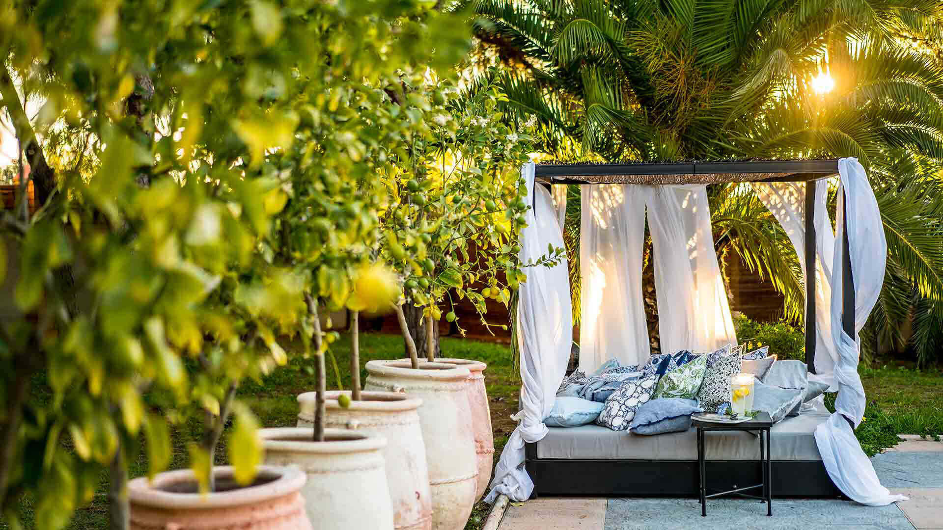 Large property outside Barcelona daybed in garden with pillows