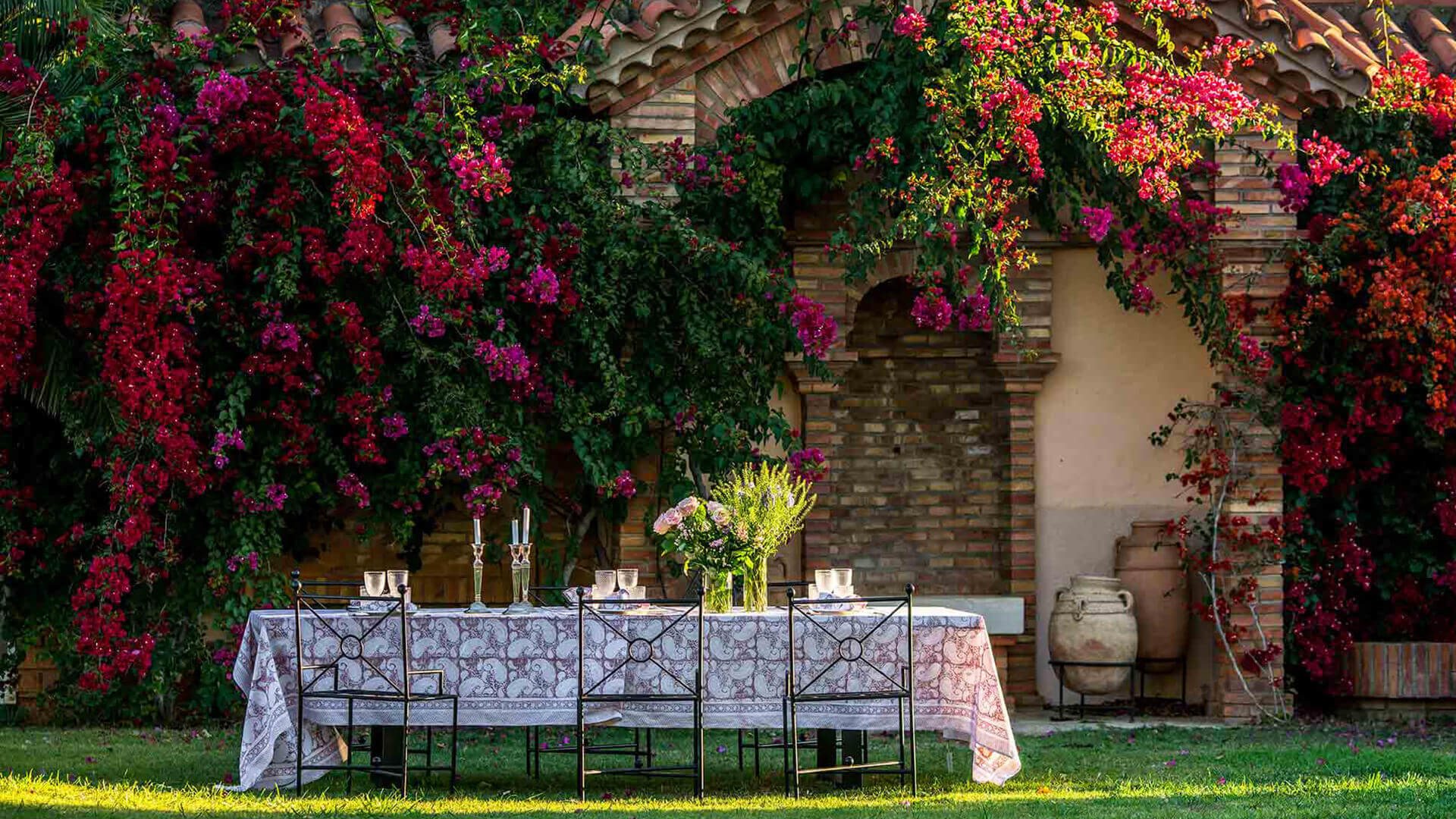 Large property outside Barcelona table in garden with red flowers