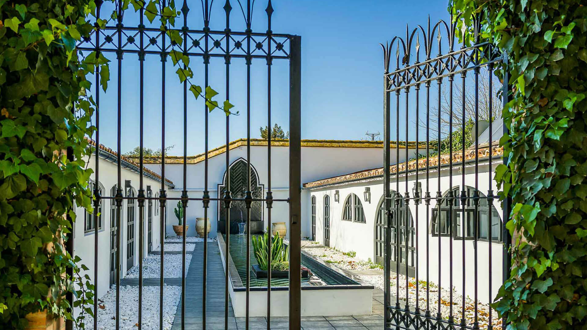 Large property outside Barcelona iron gate entrance to courtyard and fountain