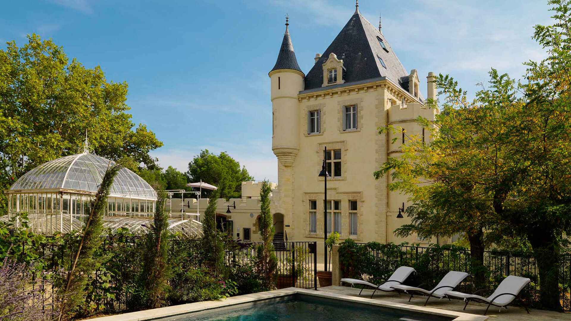 Chateau garden with swimming pool and orangerie