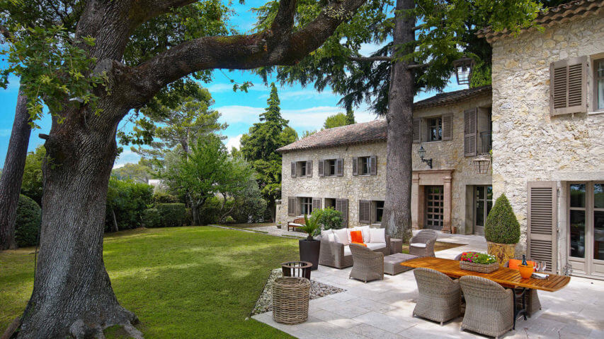 Luxury villa in Mougins patio with trees in garden and patio