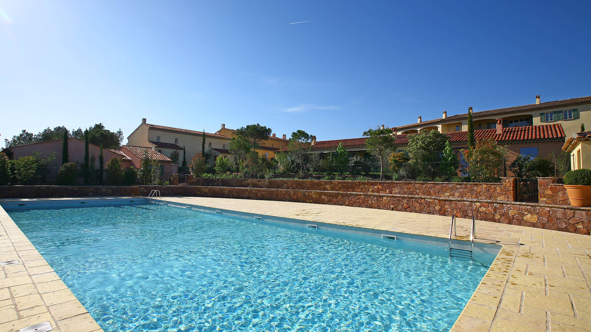 Provence golf and Spa swimming pool with villa in background