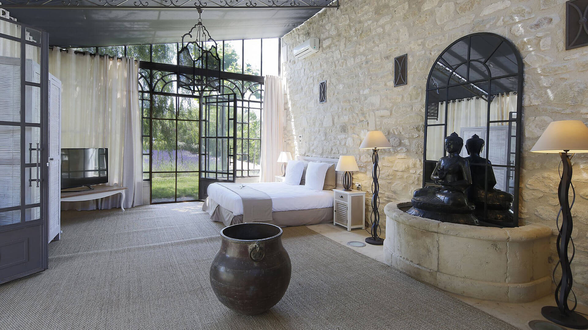 Saint Remy de Provence master bedroom with buddha