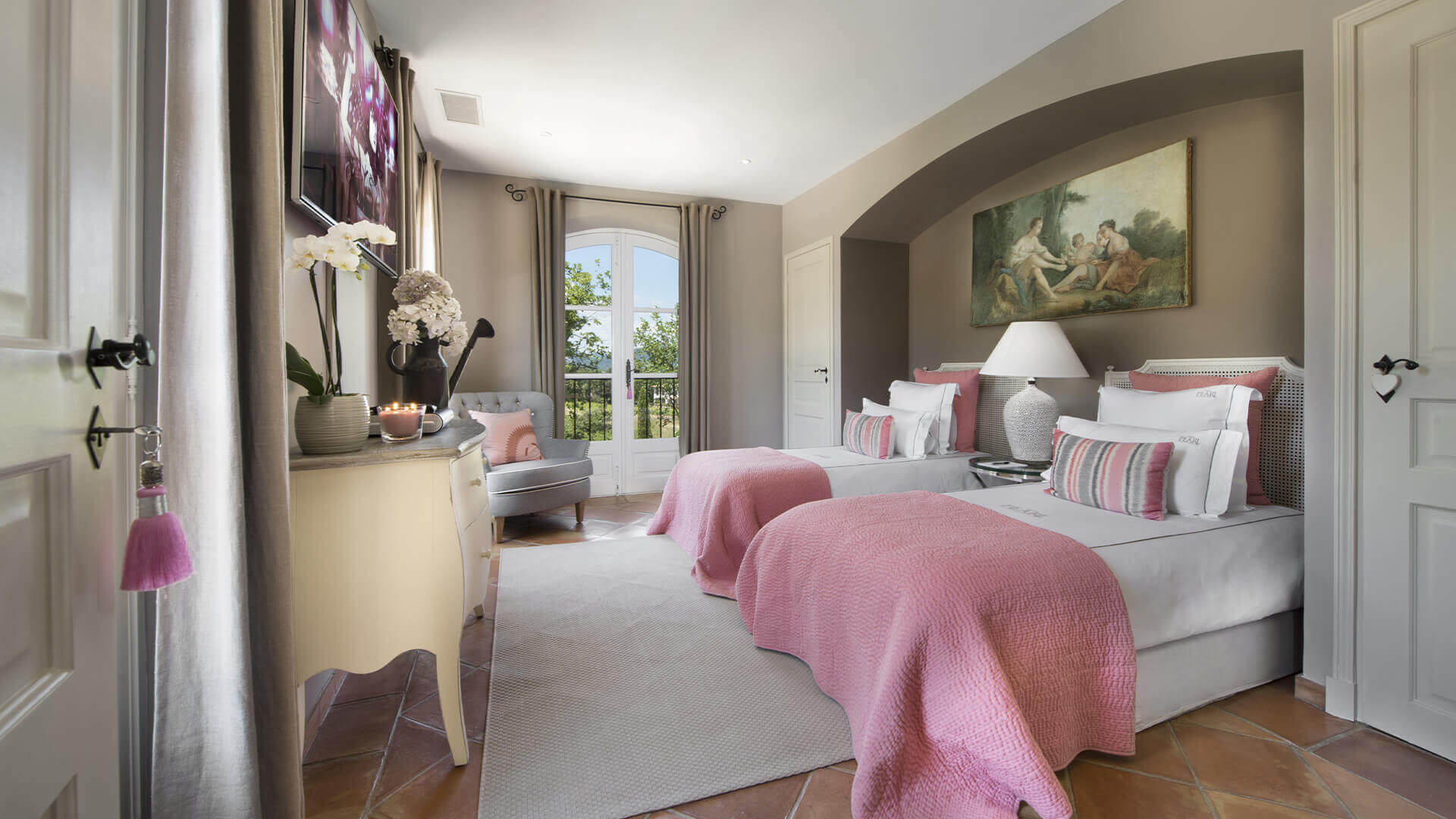 Saint Tropez Villa bedroom with two beds and pink carpets