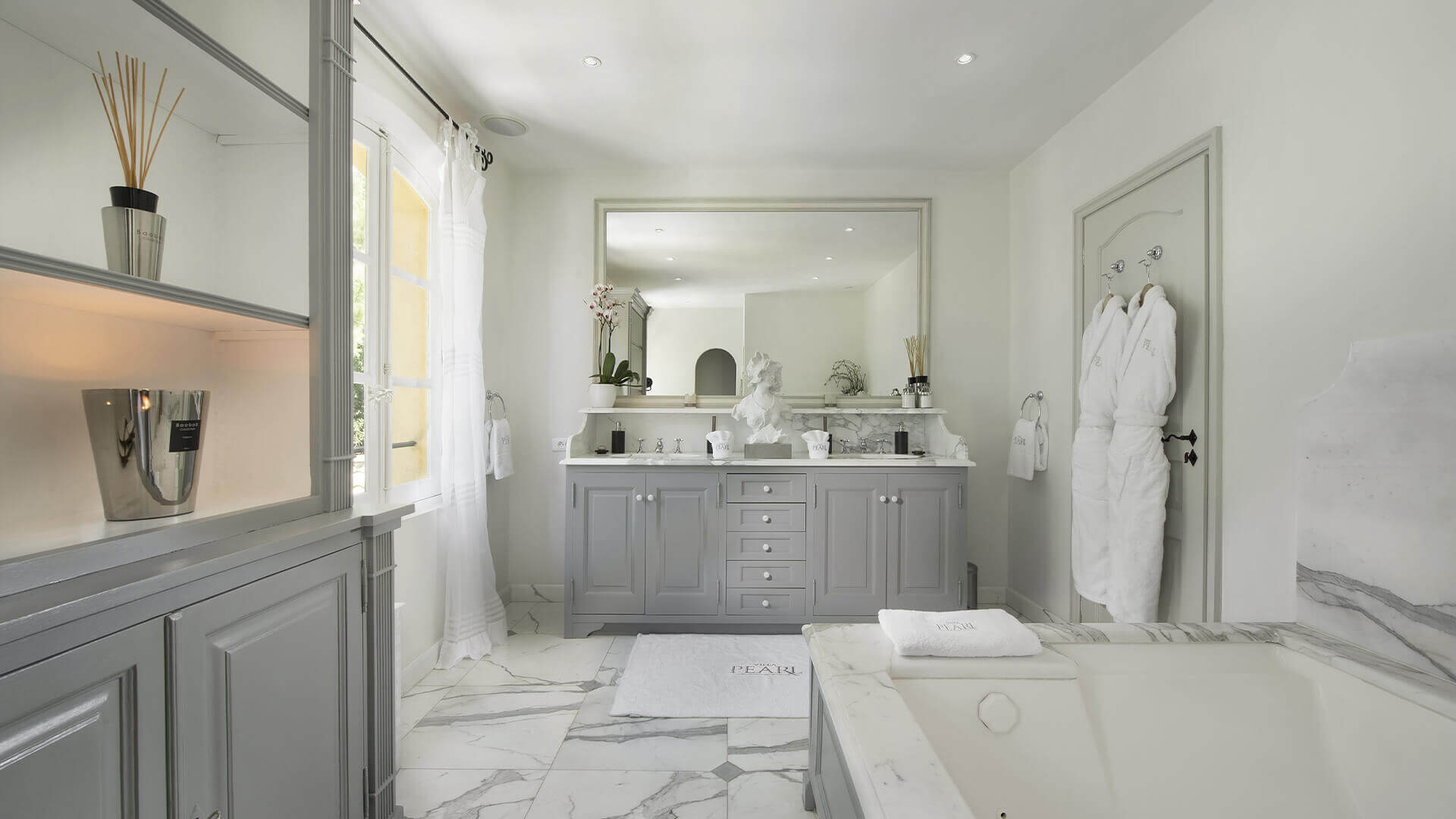 Saint Tropez Villa white marble bathroom with statue and bathtub