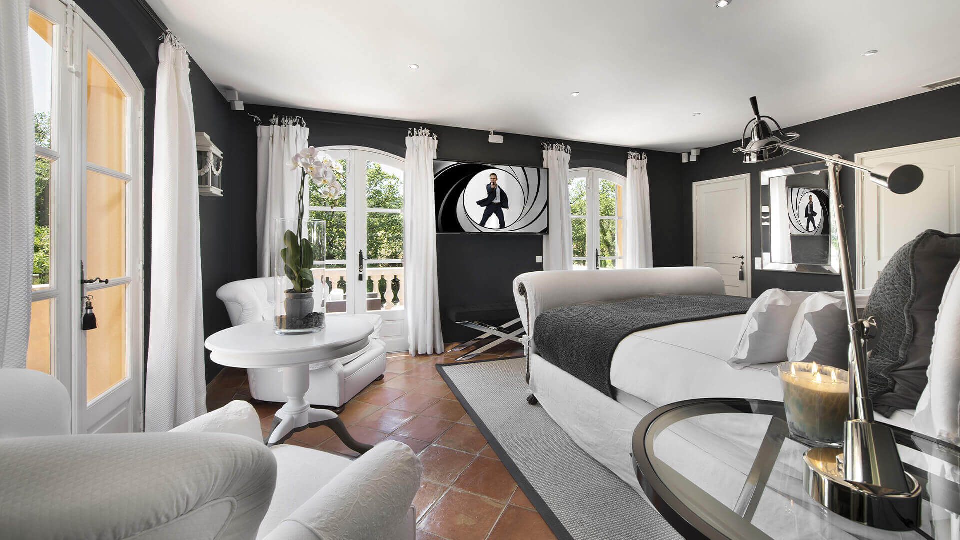 Saint Tropez Villa dark bedroom with james bond movie