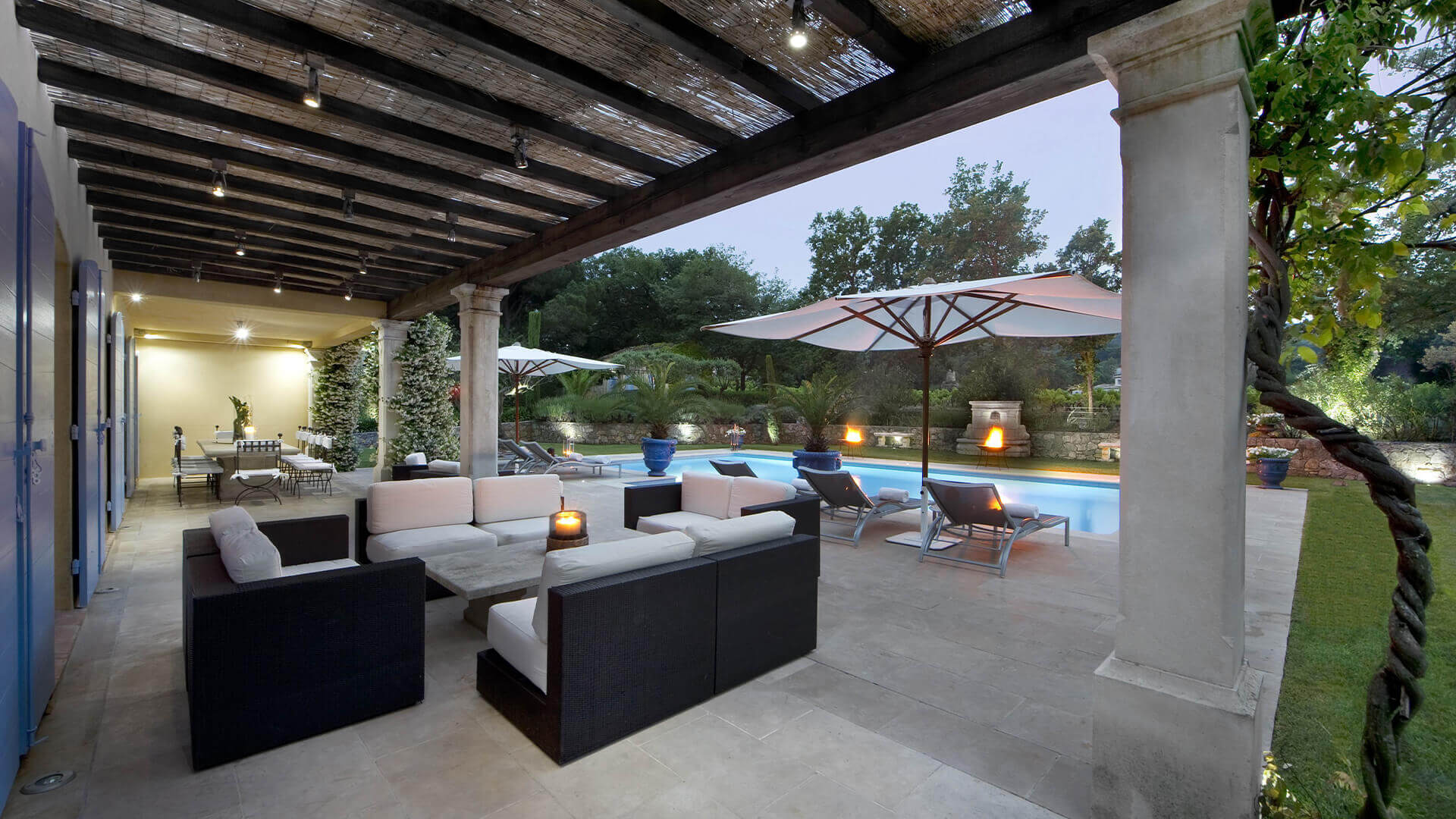 Saint Tropez Villa outdoor sitting area by the swimming pool