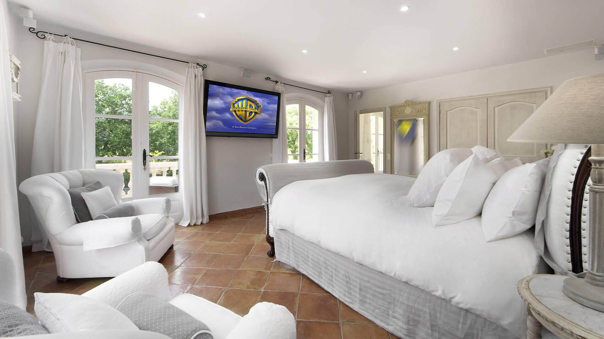 Saint Tropez Villa white bedroom with many pillows