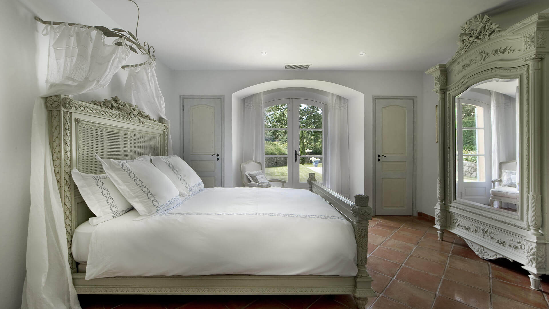 Saint Tropez Villa white renaissance style bedroom and garden view