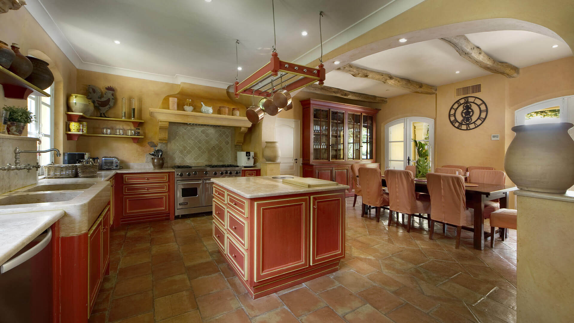 Saint Tropez Villa rustic tan kitchen and dining area