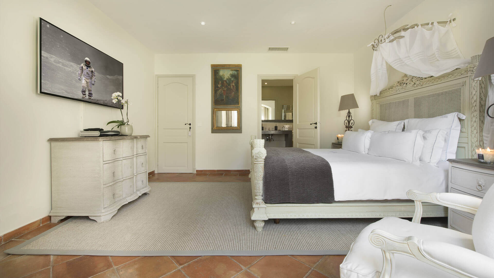 Saint Tropez Villa white rustic bedroom with interstellar movie playing