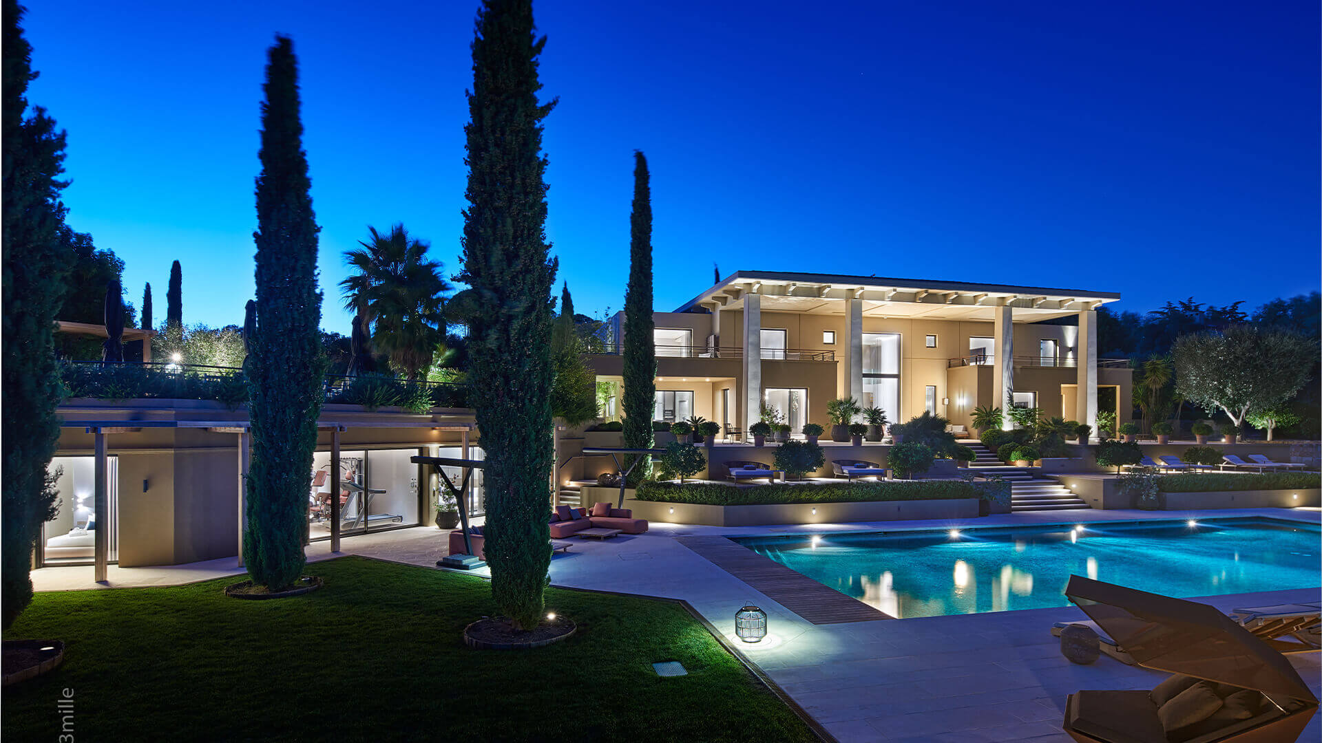 Villa at night with swimming pool
