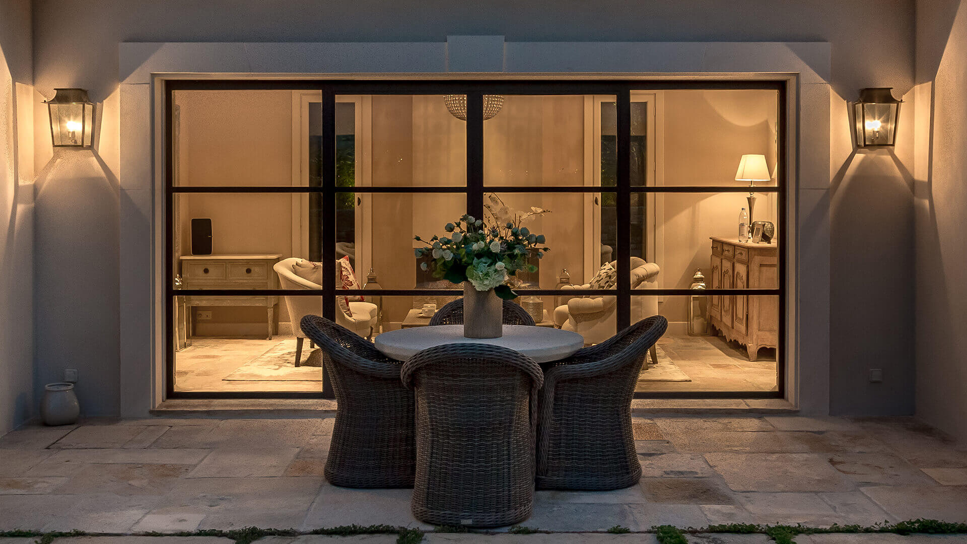 Villa Fayence patio and living room at night